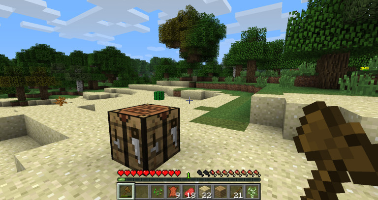 A wooden axe and a crafting table. From humble beginnings...