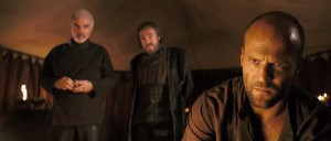 King Konreid (Burt Reynolds), Merick (John Rhys-Davies), and Farmer (Jason Stratham) convene a council before the upcoming battle with the krug.