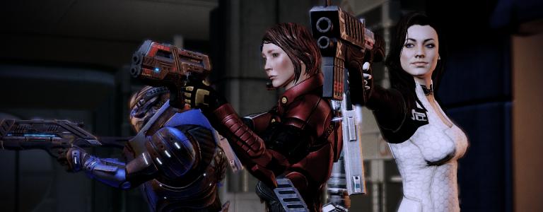 Garrus, Shepard, and Miranda hold their guns at the ready.