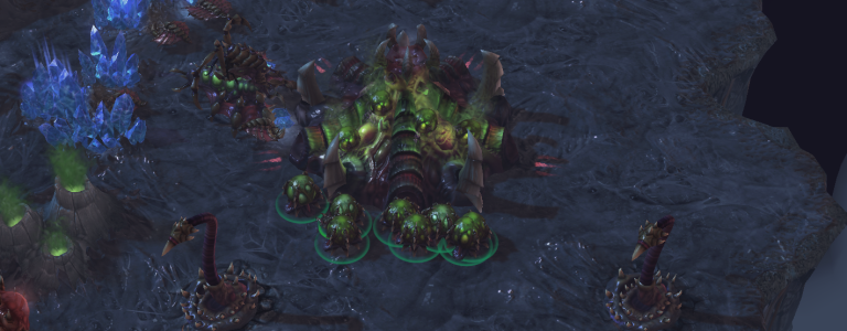 A Zerg hatchery with a number of eggs around it.