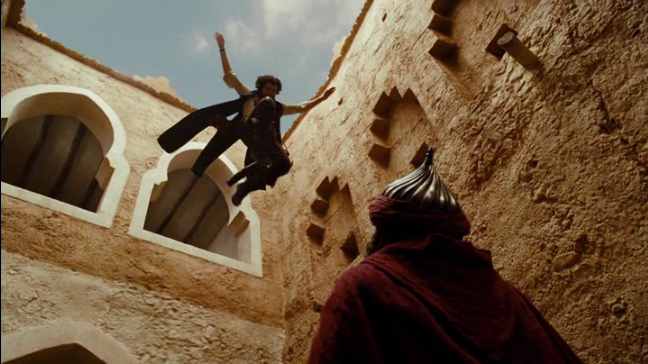 The Prince of Persia jumps from a window onto a guard.