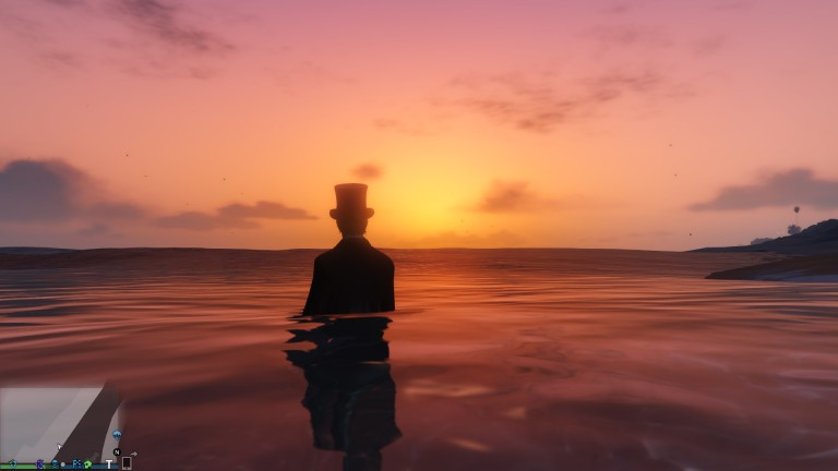Nerdsworth enjoying the beach sunset in a top hat.