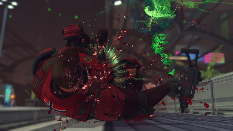 A human soldier eats a blast from a sectoid while fighting in a train yard.